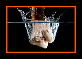 Fist beating into Water, vertical, splash
